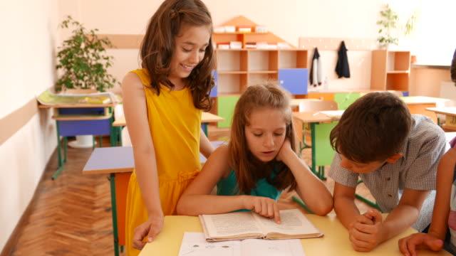 Schoolboys and schoolgirls in classroom