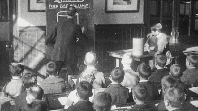 1925 MONTAGE Schoolboys in classrooms with teacher instructing them on geography, calculating the volume of a cylinder, and working on projects in woodworking class / Newcastle upon Tyne, England, United Kingdom