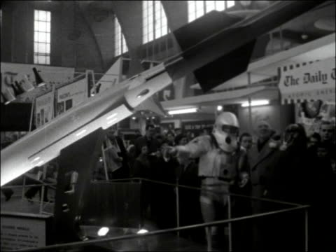 schoolboys model exibition opens; england: london: victoria: horticultural halls: ext spaceman arriving - being helped out of taxi by president of... - missile stock videos & royalty-free footage