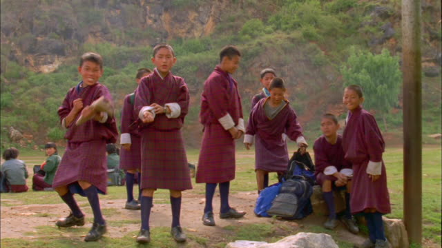 schoolboys playing and posing for camera available in hd. - bhutan stock videos & royalty-free footage