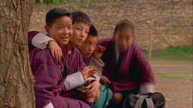 schoolboys pose for camera available in hd. - bhutan stock videos & royalty-free footage