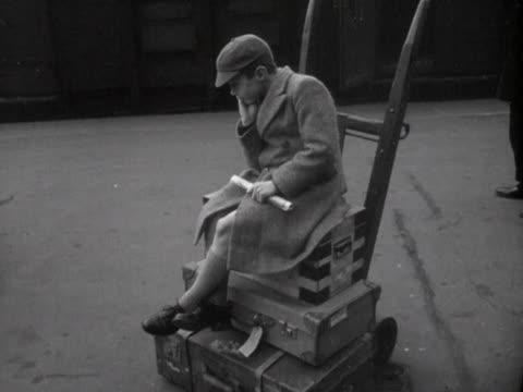 schoolboys wait on a railway platform for their train. - schoolboy stock videos & royalty-free footage