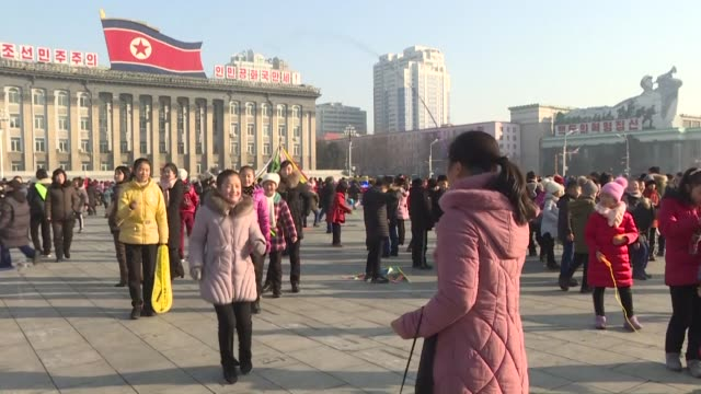 schoolchildren in the north korean capital pyongyang play in the city's central kim il sung square on lunar new year's day - korean new year stock videos & royalty-free footage