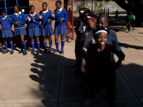 schoolchildren perform a traditional dance for singer shakira in south africa 6th june 2010 - shakira stock videos & royalty-free footage