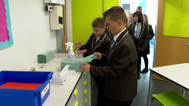 schoolchildren sanitize their desks in their classroom on their first day back at school after coronavirus lockdown, market drayton - laundry detergent stock videos & royalty-free footage