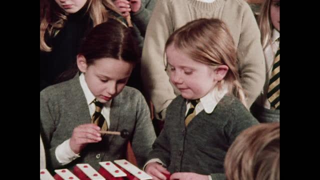 schoolchildren sing 'little donkey', 1970s - school bell stock videos & royalty-free footage