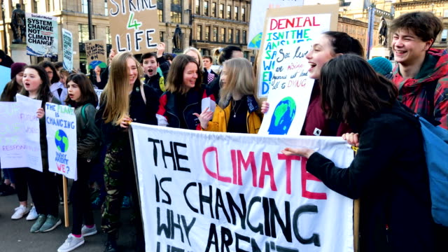 schoolchildren take part in a nationwide student climate march in george square on february 15 2019 in glasgow united kingdomthousands of uk pupils... - climate stock videos & royalty-free footage