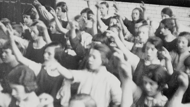 1925 montage schoolgirl in music class showing musical notes on the blackboard as the teacher plays the notes on piano, and schoolgirls wearing gymslips perform calisthenics on playground / newcastle upon tyne, england, united kingdom - 1925 stock videos & royalty-free footage