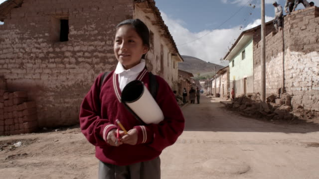 a schoolgirl leaves for school, peru - shears stock videos & royalty-free footage