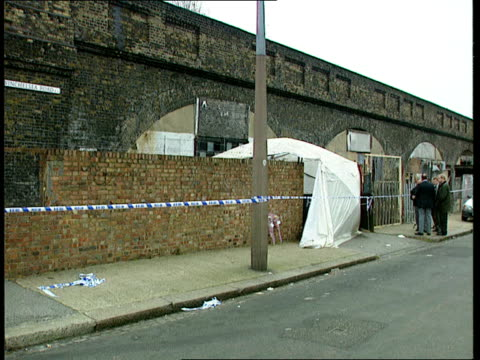 london forest gate lms cordoned off area around yard with tarpaulin over site where body found bv three men standing talking by cover ms policeman rl... - seilabsperrung stock-videos und b-roll-filmmaterial