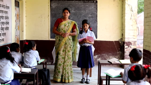 schoolgirl reading a book in classroom, haryana, india - schoolgirl stock videos & royalty-free footage