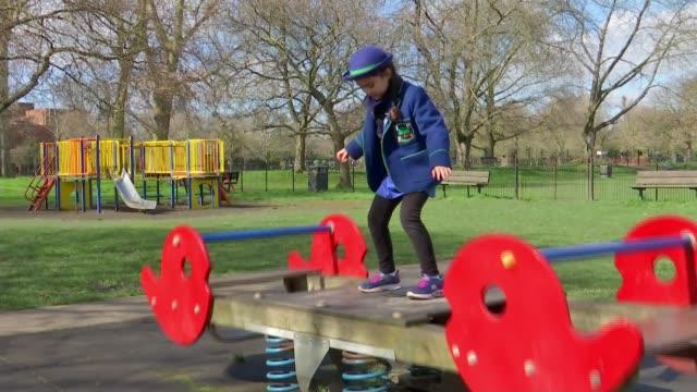 schoolgirl records coronavirus-themed song to cheer up classmates; england: london: hammersmith: ext gv rebecca bright standing / playing / dancing... - schoolgirl stock videos & royalty-free footage