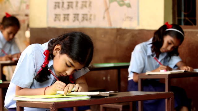 schoolgirl studying in classroom, haryana, india - note pad stock videos & royalty-free footage