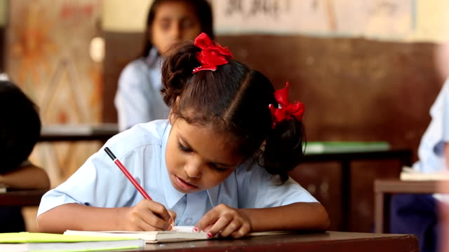 schoolgirl studying in classroom, haryana, india - schoolgirl stock videos & royalty-free footage