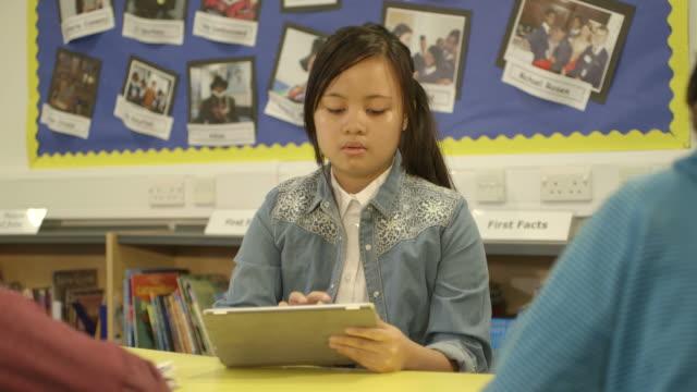 Schoolgirl using tablet