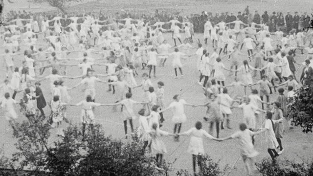 1925 montage schoolgirls en masse performing choreographed dance on outdoor court, and schoolgirls playing netball outdoors on playground / newcastle upon tyne, england, united kingdom - 1925 stock videos & royalty-free footage