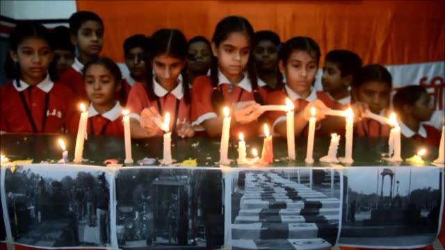 Schoolgirls pay tribute to the 18 Indian soldiers killed in a militant attack at an army base in Uri