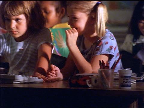 pan schoolgirls using computer in classroom - endast flickor bildbanksvideor och videomaterial från bakom kulisserna