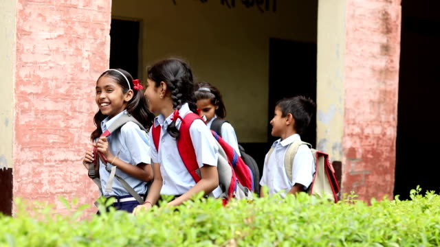 schoolgirls walking in school campus, haryana, india - schoolgirl stock videos & royalty-free footage