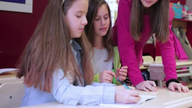 Schoolgirls working in class