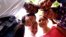 Schoolkids forming huddle in school premises 4k