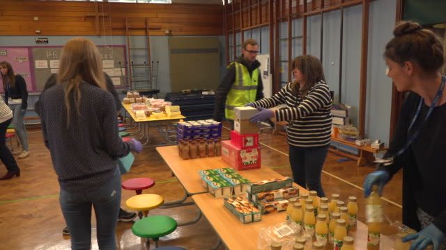 schools in worcestershire putting together and delivering food parcels to families during coronavirus lockdown who are entitled to free school meals... - document stock videos & royalty-free footage