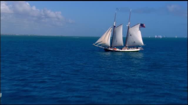 low aerial, schooner sailing in ocean, key west, florida, usa - sailing ship stock videos & royalty-free footage