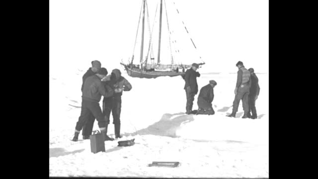 schooner stuck in ice crew members getting buckets of melted ice to resupply ship / ms crew member scooping up water / crew using pole as fulcrum to... - effie stock videos and b-roll footage