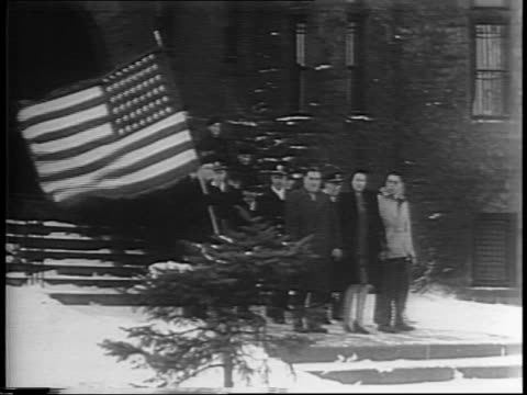 schremph family and navy officers carry american flag out of armory / jacob, pauline, and william schremph lift right hands as entire family is sworn... - 武器庫点の映像素材/bロール