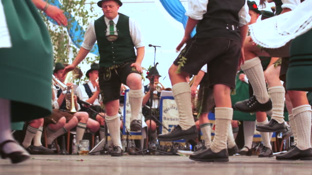 slo mo schuhplattler performance in bavarian beer tent - german culture stock videos & royalty-free footage
