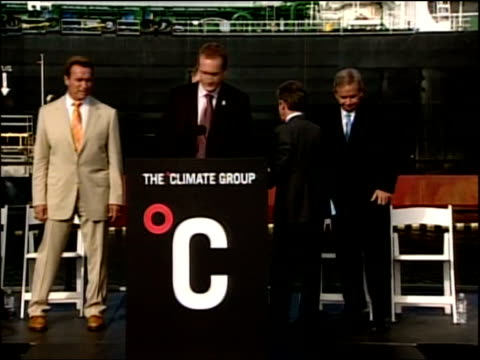 Schwarzenegger and Blair unite on global warming Press conference Photocall of Blair and Schwarzenegger standing with business leaders / Blair and...