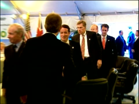 Schwarzenegger and Blair unite on global warming Press conference Blair and Schwarzenegger into room for meeting of the The Climate Group Climate and...