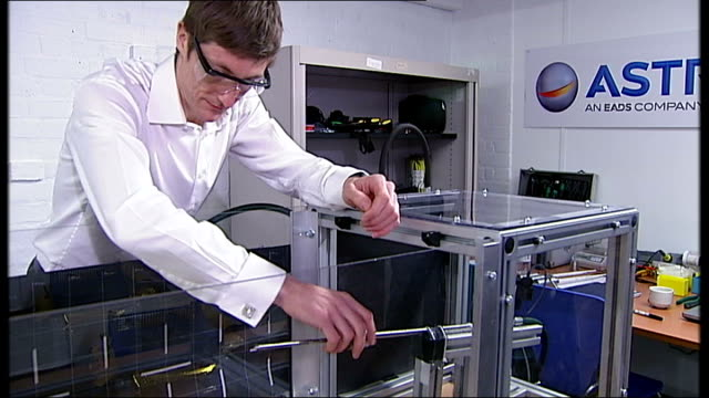 british engineers developing harpoon to clean up space junk england hertfordshire stevenage astrium int engineer setting harpoon bv harpoon fired and... - harpoon stock videos and b-roll footage