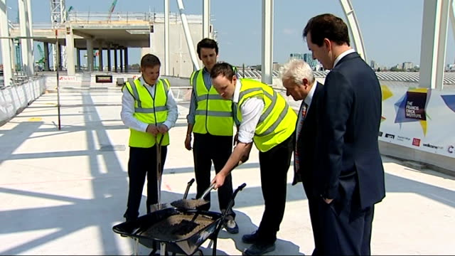 george osborne attends francis crick institute george osborne along with sir paul nurse / osborne and nurse shovelling cement into place for topping... - francis crick stock videos & royalty-free footage