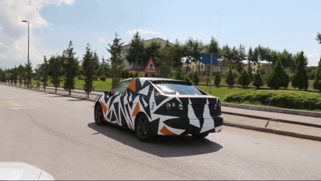 science industry and technology minister fikri isik tests the prototype of first nationally made electric car in ankara turkey on 13 october 2015 - prototype stock videos & royalty-free footage