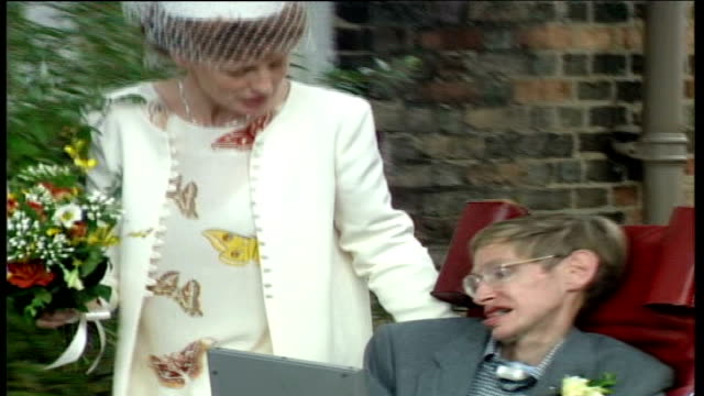 Stephen Hawking 'end of the world' warning TX Cambridge EXT Stephen Hawking with his second wife Elaine posee for press at their wedding ceremony