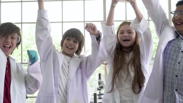 science students celebrate and cheers for conducting science project - school science project stock videos & royalty-free footage