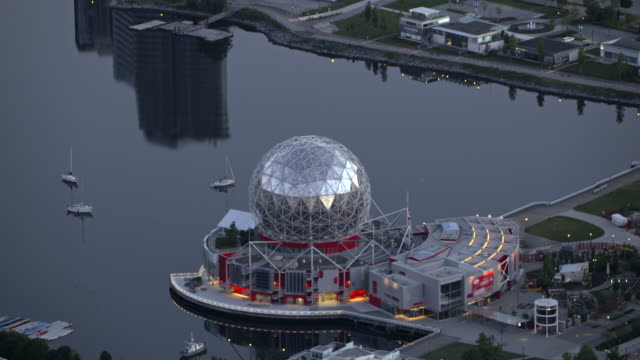aerial science world at telus world science located at the end of false creek in vancouver - kuppeldach oder kuppel stock-videos und b-roll-filmmaterial