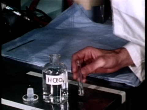 1976 cu scientist adding alcohol to test tube / united states / audio  - pipette stock videos & royalty-free footage