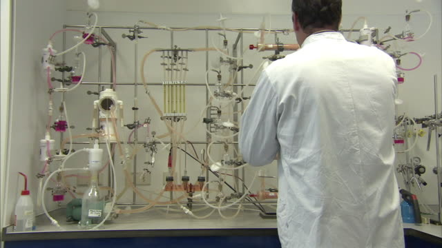 ms scientist adjusting vials and test tubes set up for chemistry experiment, boxmeer, netherlands - biochemistry stock videos & royalty-free footage