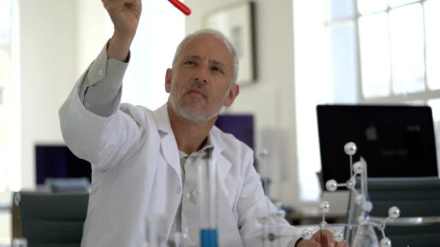 Scientist analyzing sample by molecular structure