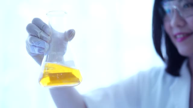 scientist checking chemical liquid to flask with lab glassware,microbiological pipette in the genetic laboratory. - laboratory glassware stock videos & royalty-free footage