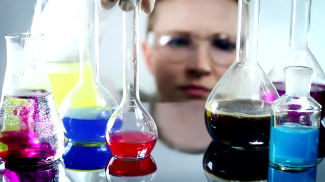 scientist classifying liquid sample in a laboratory - the natural world stock videos & royalty-free footage