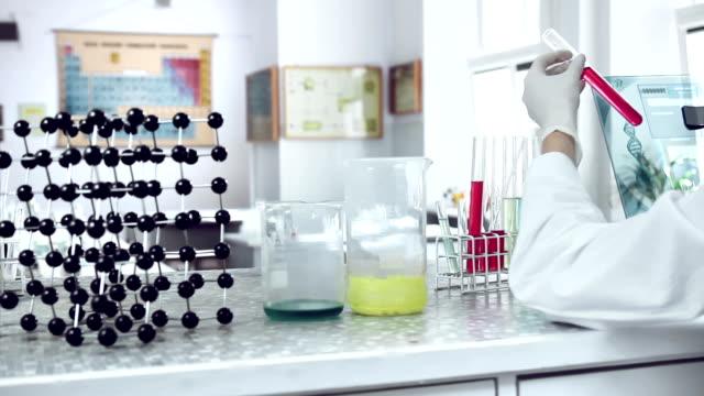 Scientist classifying liquid sample in a laboratory.