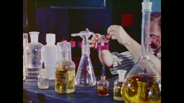 scientist conducting chemistry experiments - pipette stock videos & royalty-free footage