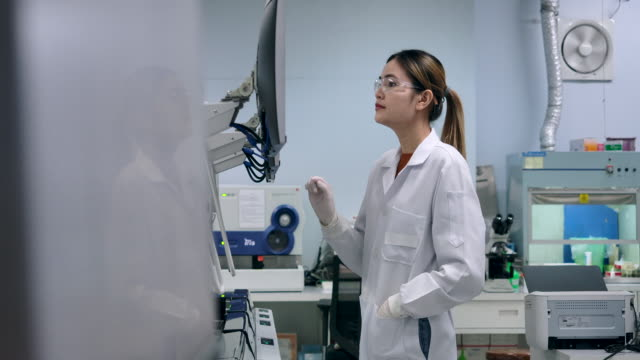 scientist data validation using a computer and use the touch screen use modern technology in the operation. 4k resolution slow motion. - esami del sangue video stock e b–roll