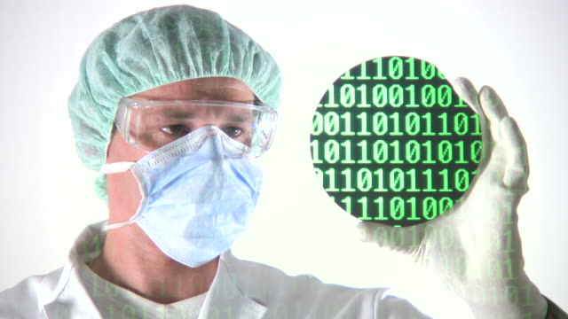 Scientist Examining Computer Chip Wafer