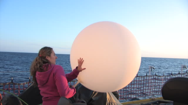 scientist fills weather balloon on the deck of the amundsen the arctic september 19 2008 – from the historic 17month expedition involving 250... - climate scientist stock videos & royalty-free footage