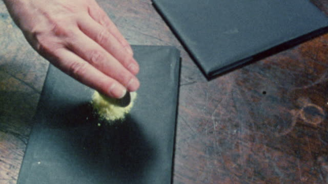 vídeos y material grabado en eventos de stock de 1983 reenactment scientist henri becquerel performing radioactivity experiments with minerals on paper and an electrometer in 1896 / united kingdom - 1983