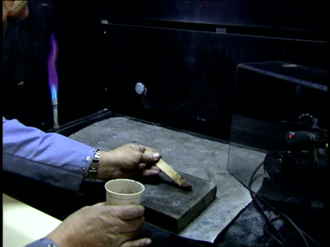 a scientist ignites a mixture with a bunsen burner. - bunsen burner stock videos & royalty-free footage